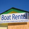 Boat rental sign shows boat hire